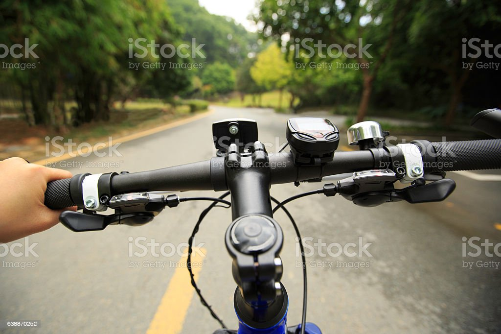 riding mountain bike at forest trail stock photo