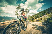 woman riding moutain bike in the forest