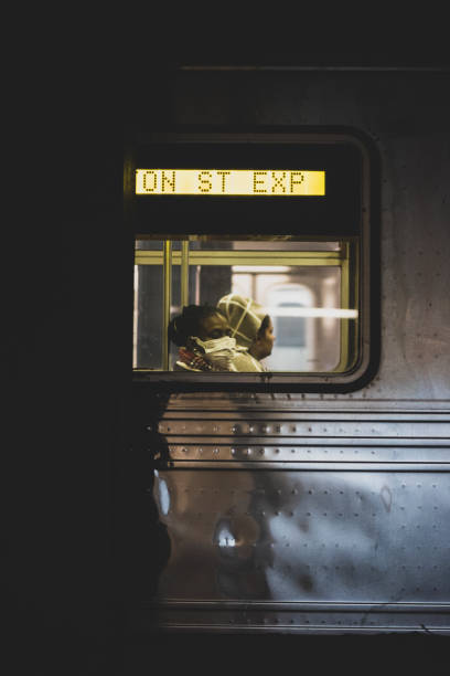 Riding New York City subway with face mask stock photo
