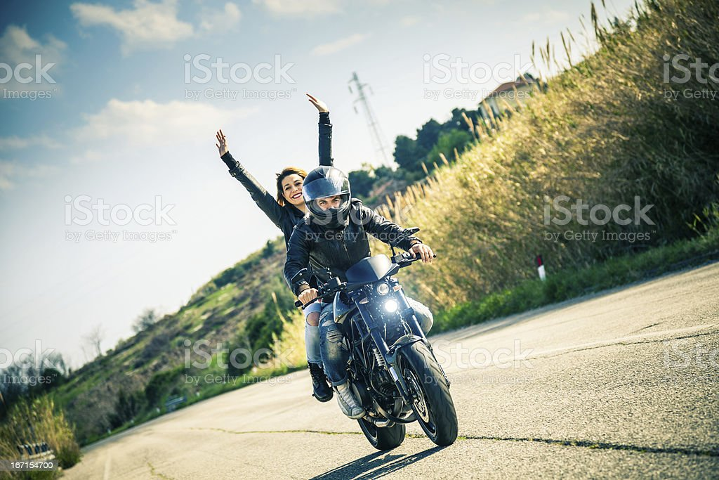 Riding on a fast motorcycle with girlfriend stock photo