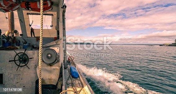 Lobster boat cruising among the islands near Stonington, Maine.