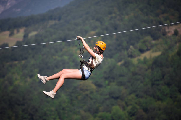 Riding on a zip line Riding on a zip line zip line stock pictures, royalty-free photos & images