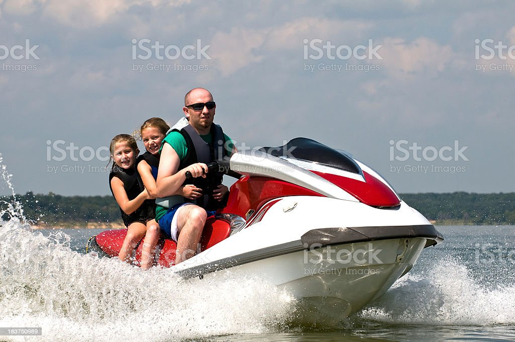 Riding on personal water craft royalty-free stock photo
