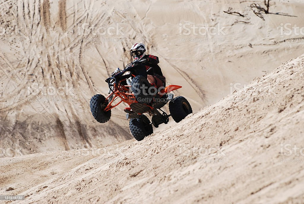 Riding Quadbike on sand dunes stock photo
