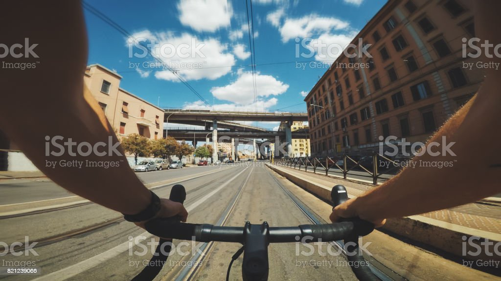 POV riding: road racing bicycle in the city stock photo