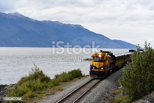 A train from the Alaska Railroad travels south along the Turnagain Army near Anchorage, Alaska.
