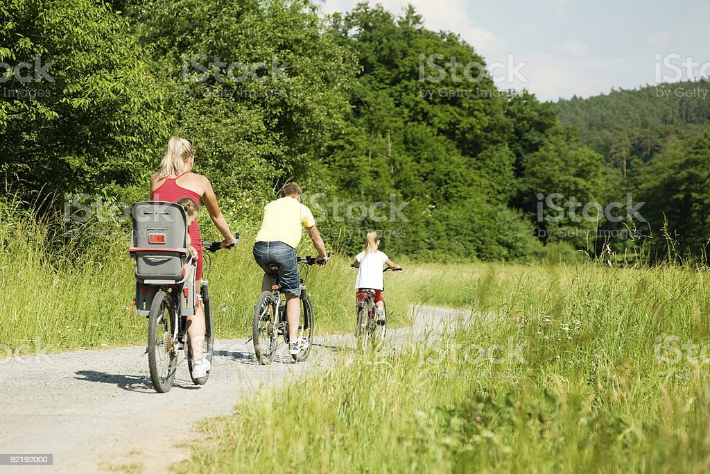 Riding the bicycles together royalty-free stock photo