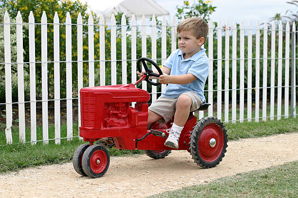 Riding the big red tractor  bunnylady stock pictures, royalty-free photos & images