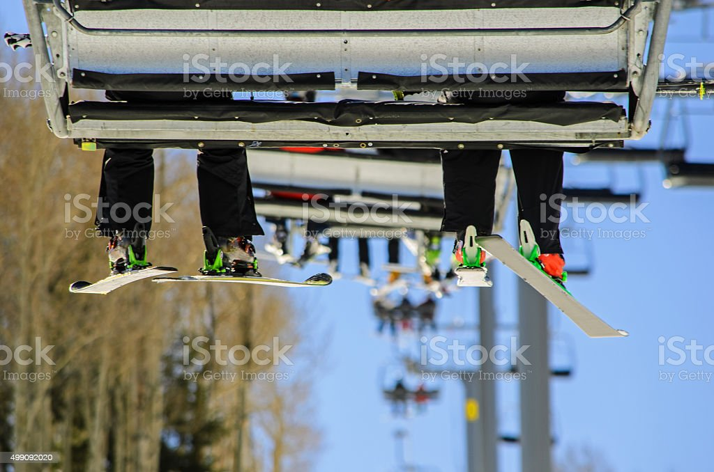 Riding the Chairlift at a Ski Resort stock photo