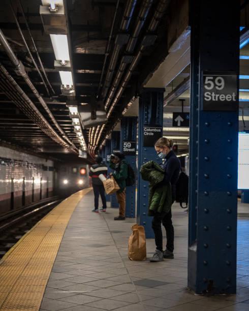 Riding the New York City subway during Coronavirus Pandemic stock photo