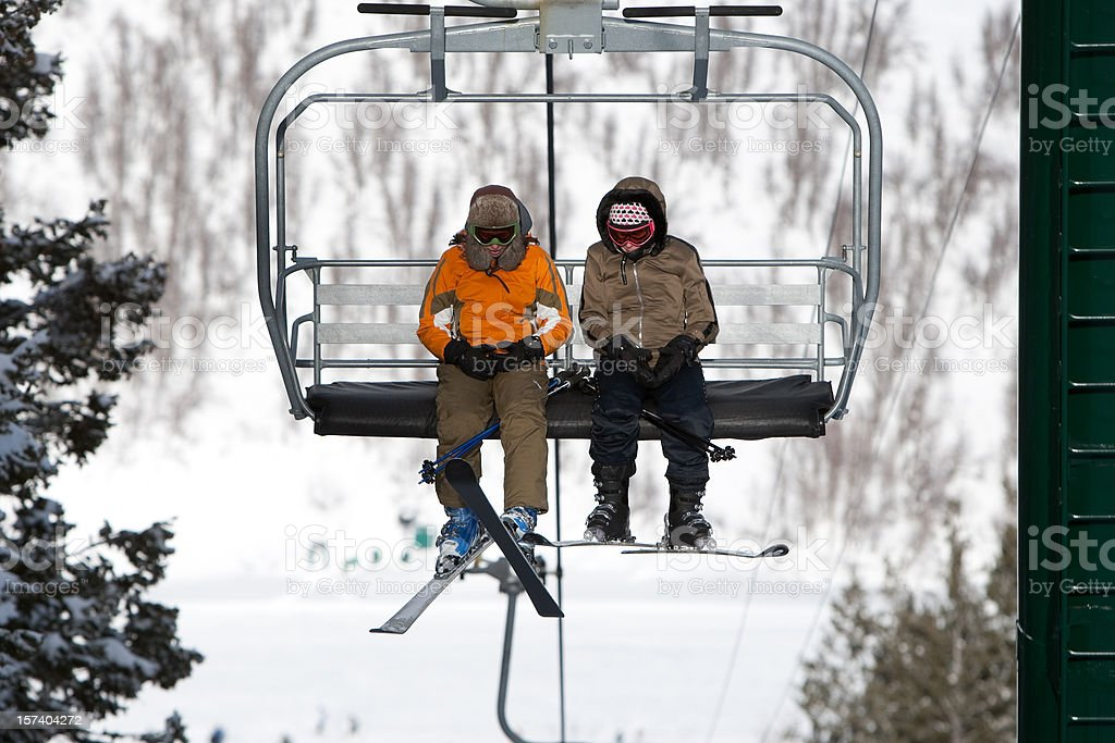 Riding the Ski Lift stock photo