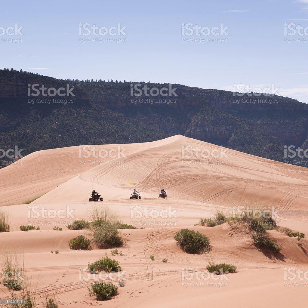 ATV riding through Sand Dunes stock photo