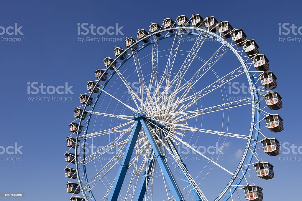 riesenrad at munich octoberfest against clear blue sky stock photo