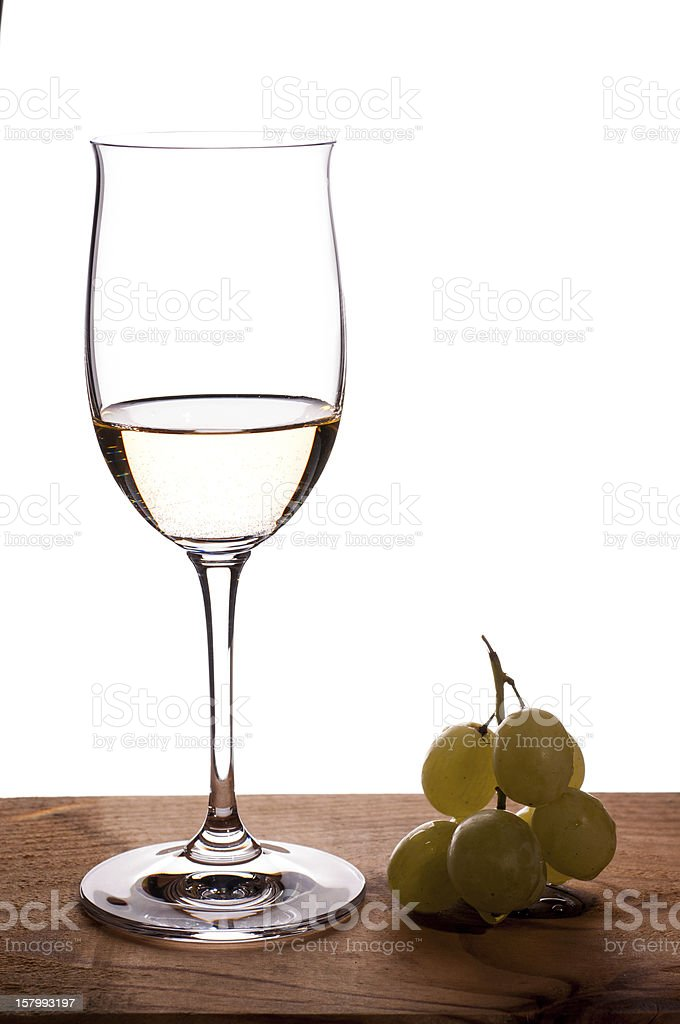 Riesling white wine in a wineglass royalty-free stock photo