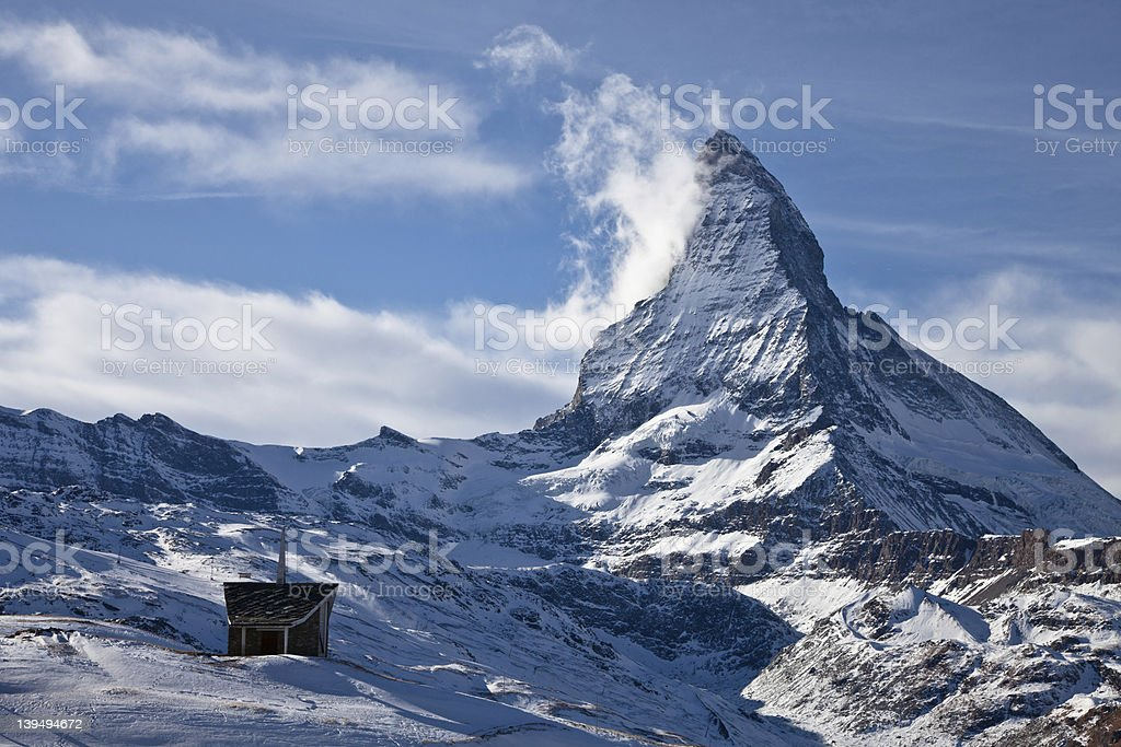 Riffelberg Chapel in the snow below the Matterhorn royalty-free stock photo