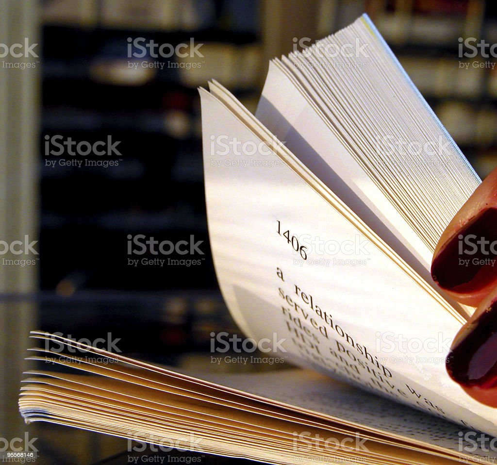 Riffling Through A Book stock photo