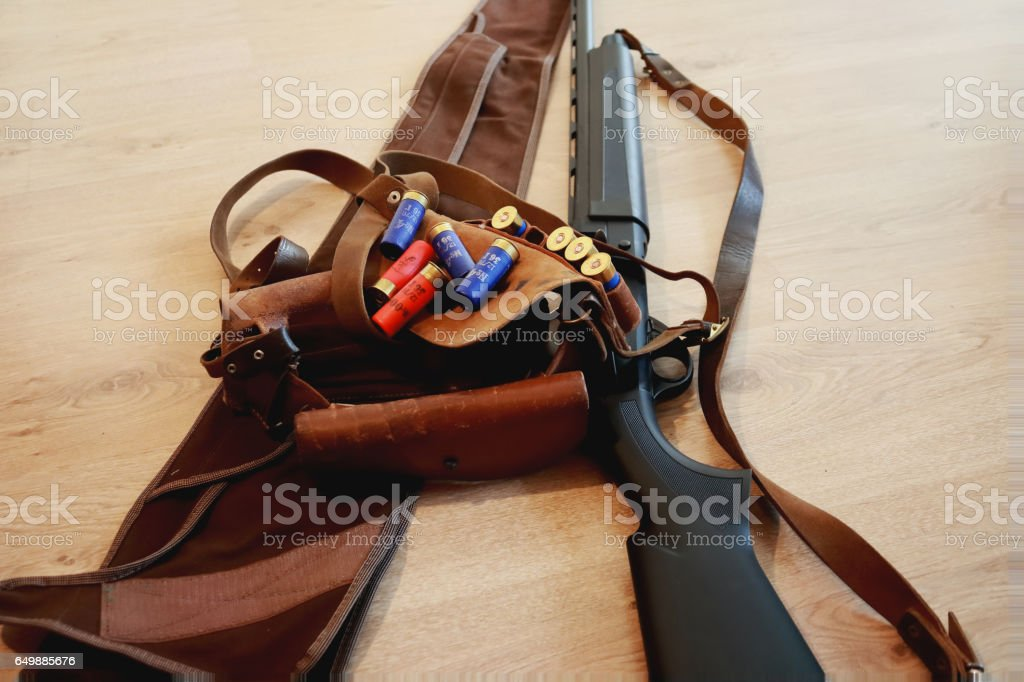 Rifle ammunition,  cartridges, bandolier and semi-automated shotgun black color, cover for shotgun stock photo