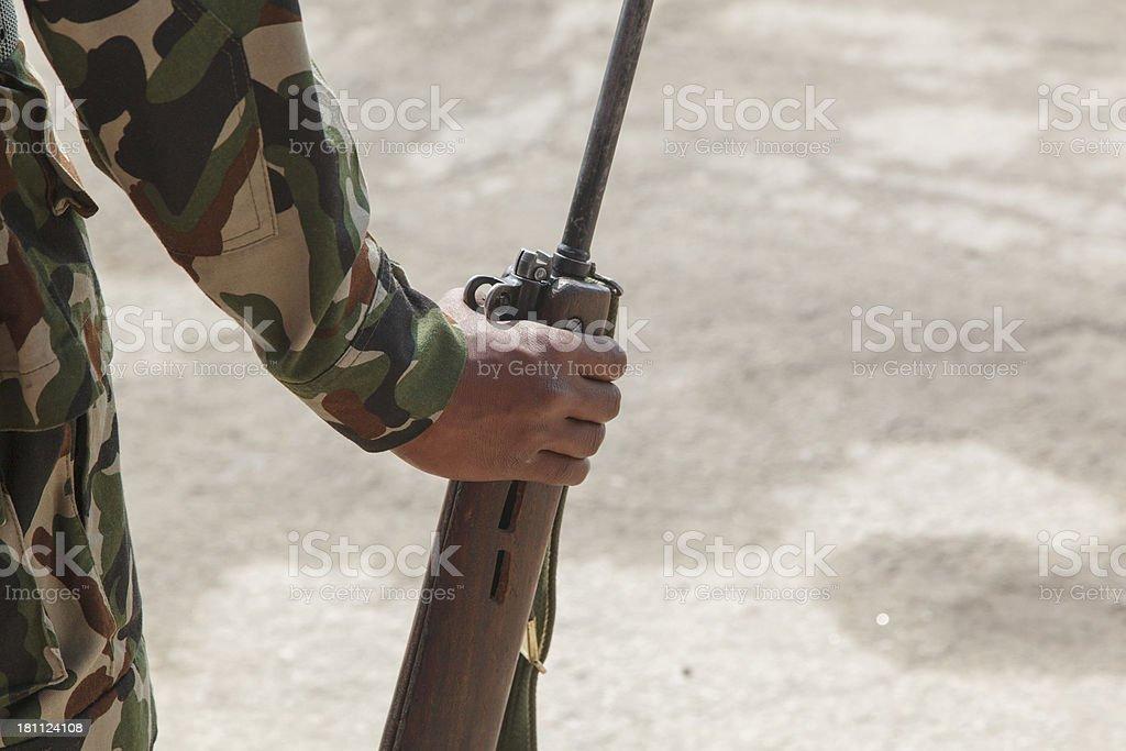 Rifle and camoflaged arm stock photo