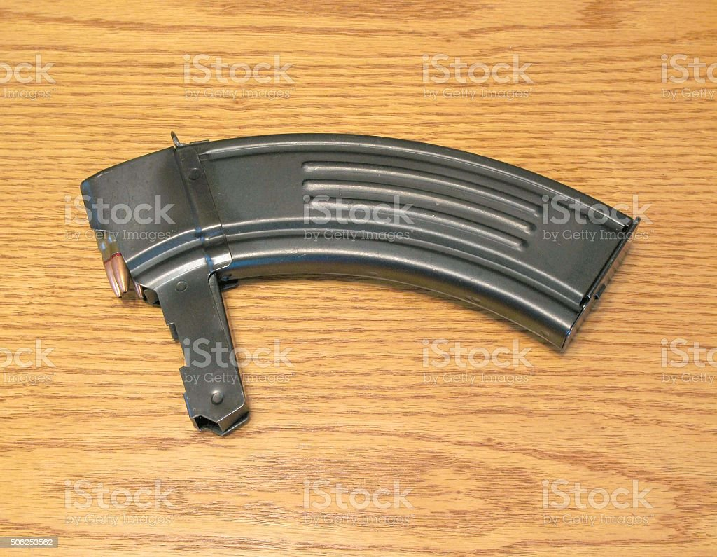 Rifle Banana Clip With Bullets On Wood Surface Stock Photo More
