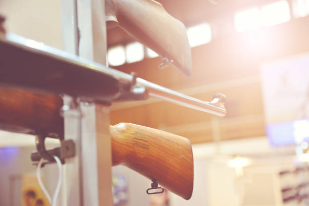 Rifle barrel in hunter shop Rifle barrel in hunter shop gun shop stock pictures, royalty-free photos & images