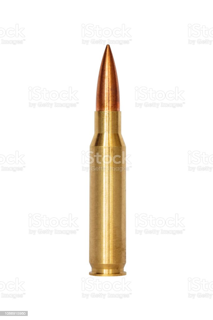 A rifle bullet over white background stock photo