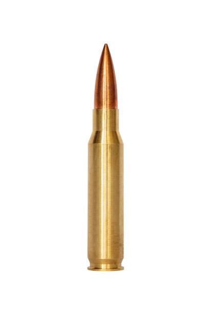 a rifle bullet over white background - proiettile foto e immagini stock