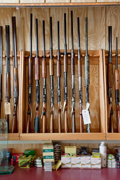Rifle in Gun Shop Rifles on display in gun shop gun shop stock pictures, royalty-free photos & images