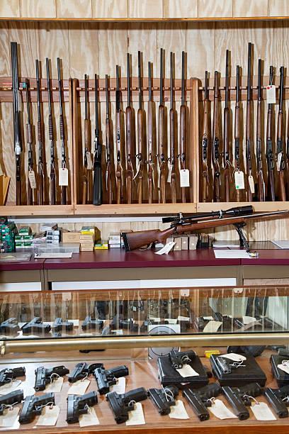 Rifle in Gun Shop Weapons displayed in gun shop gun shop stock pictures, royalty-free photos & images