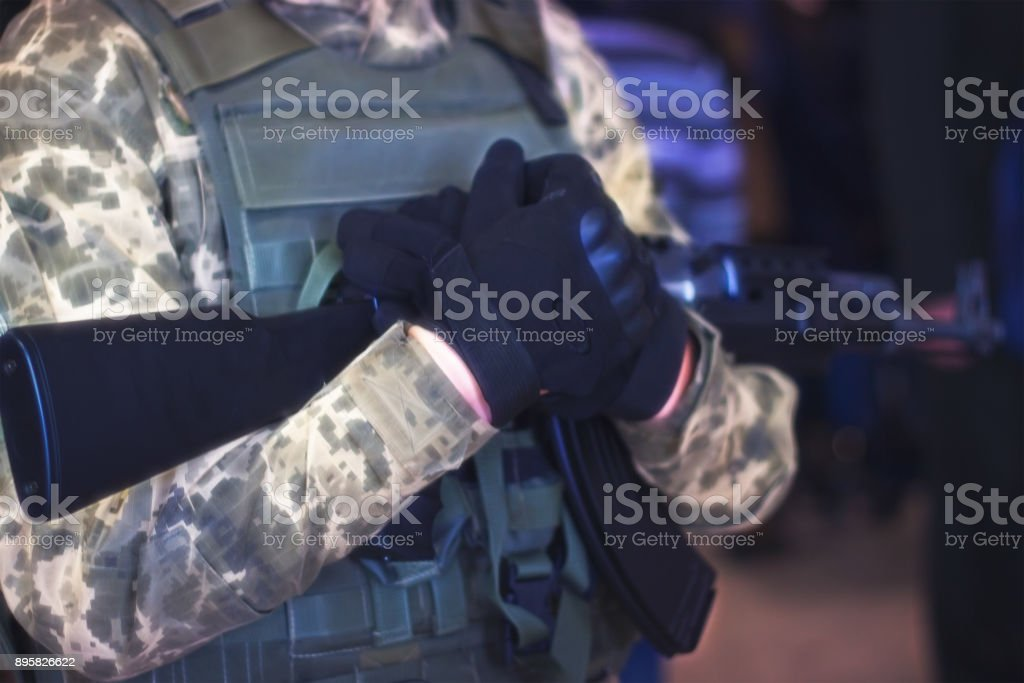 rifle in the hands of the military. War in Ukraine. Anti-terrorist operation. Armed forces. National guard. stock photo