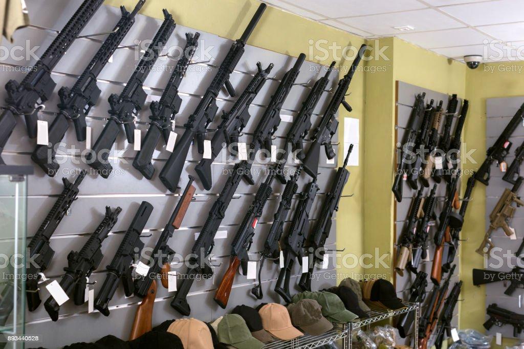Rifle kalashnikov hangs on the wall stock photo