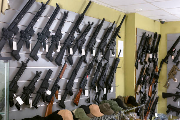 Rifle kalashnikov hangs on the wall stock photo
