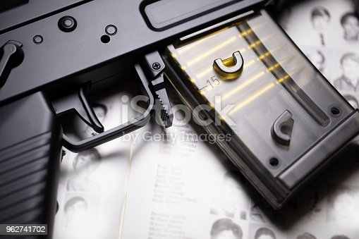 Toy airsoft gun on book with page open