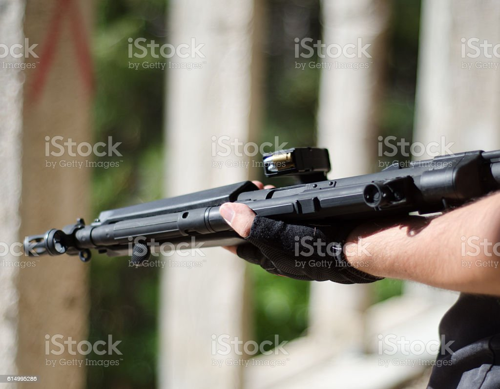 rifle on hand stock photo