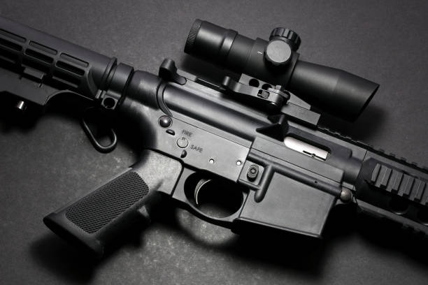 AR15 rifle AR15 rifle with scope on black background ar 15 stock pictures, royalty-free photos & images