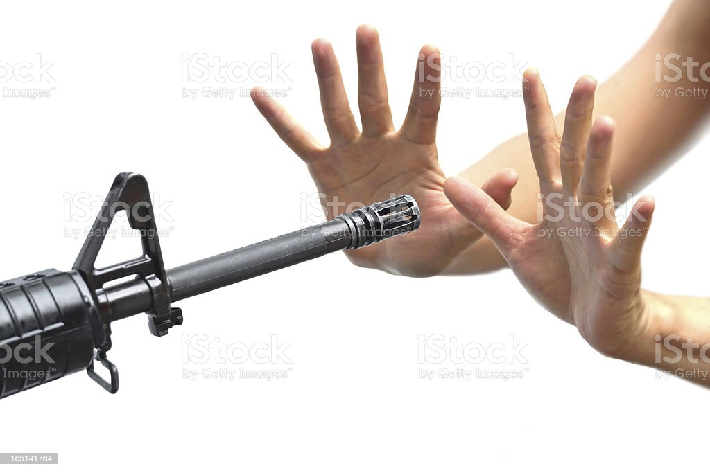 Rifle pointing to empty hands royalty-free stock photo