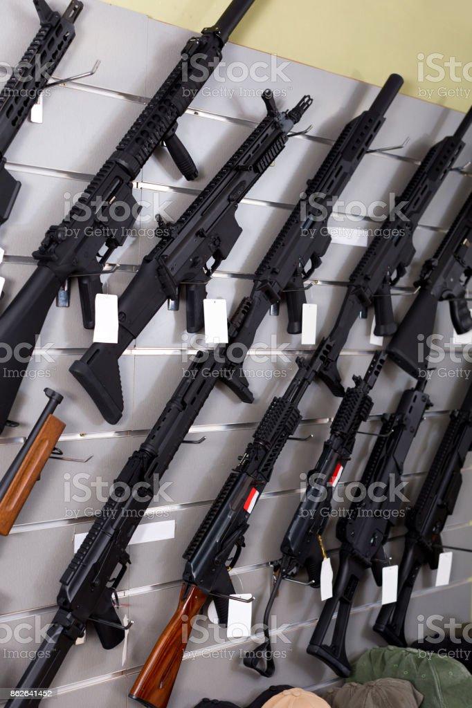 Rifles hangson the wall stock photo