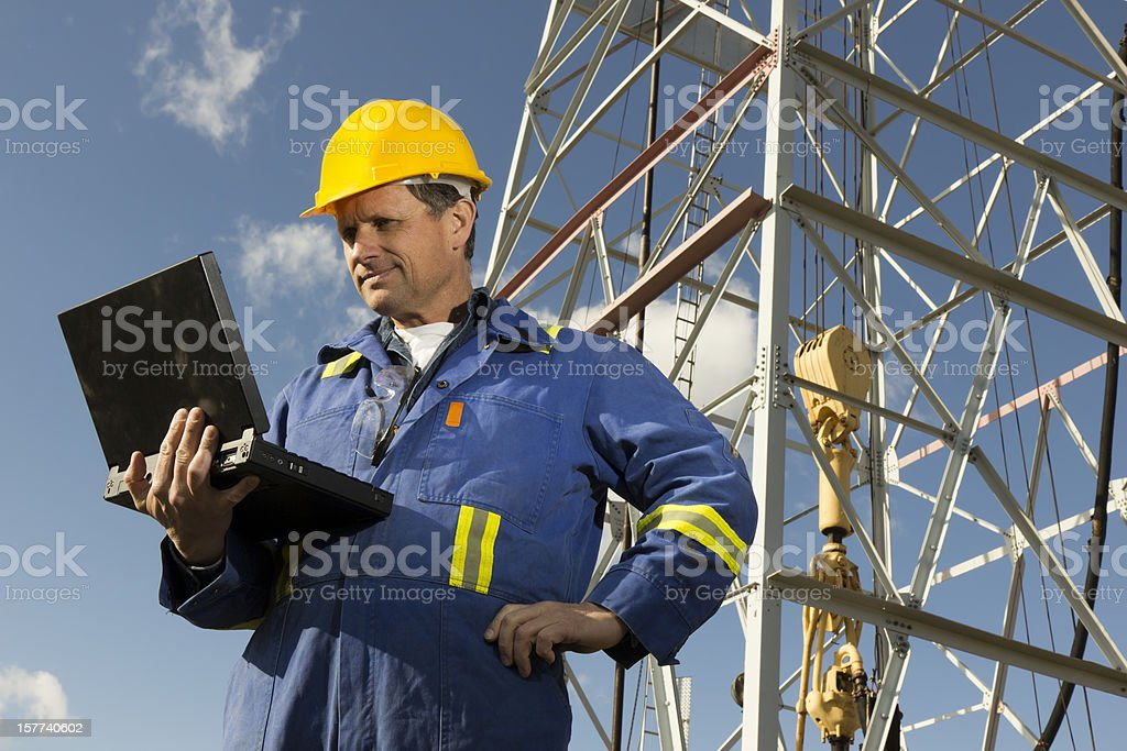 Rig Worker and Laptop royalty-free stock photo