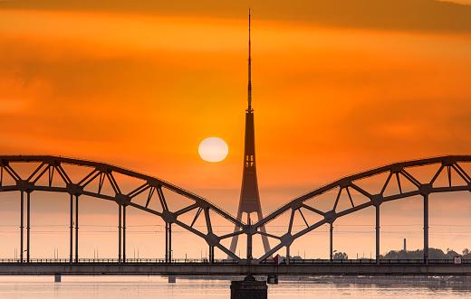 Riga, amazing sunset over Daugava river, bridge and TV tower, Latvia