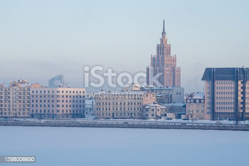 Riga buildings on the bank of the Daugava river in the winter morning. The Stalin era building of Latvian Academy of Sciences can be seen in the distance. The Latvian Academy of Science is the official science academy of Latvia and is an association of the country's foremost scientists