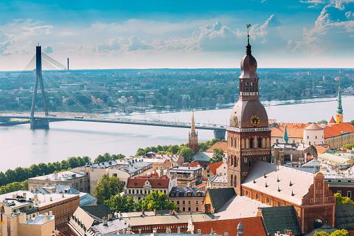 Riga, Latvia. Cityscape In Sunny Summer Day. Famous Landmark - Riga Dome Cathedral