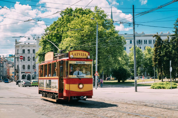 Riga, Latvia. Red retro Vintage Public Tram In Street In Riga. stock photo