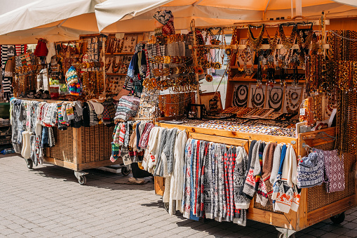 Riga, Latvia. Street Market In Livu Square. Trading Houses With Sale Of Gifts, Sweets And Souvenirs Made From Wood And Amber
