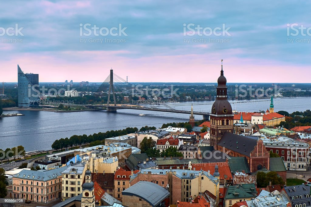 Riga, Latvia: sunset aerial view of Old Town and Daugava River. The tower of Dome Cathedral, a symbol of the city. royalty-free stock photo