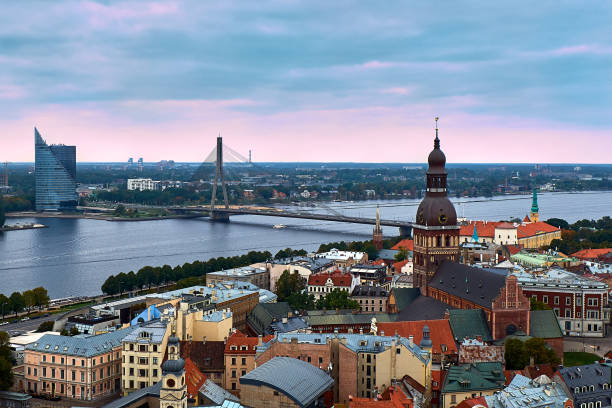 Riga, Latvia: sunset aerial view of Old Town and Daugava River. The tower of Dome Cathedral, a symbol of the city. stock photo