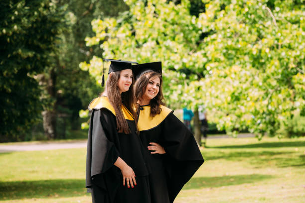 riga, latvia. two young women graduates of the university of lat - beautiful college girl pics stock photos and pictures