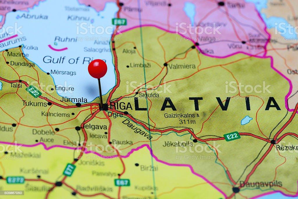 Riga pinned on a map of Latvia stock photo