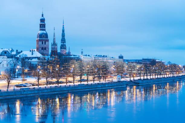 Riga towers in winter Quay of Daugava River in Riga, Latvia latvia stock pictures, royalty-free photos & images