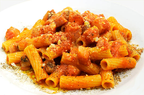 Rigatoni all'amatriciana Rigatoni all'amatriciana on a white background rigatoni stock pictures, royalty-free photos & images