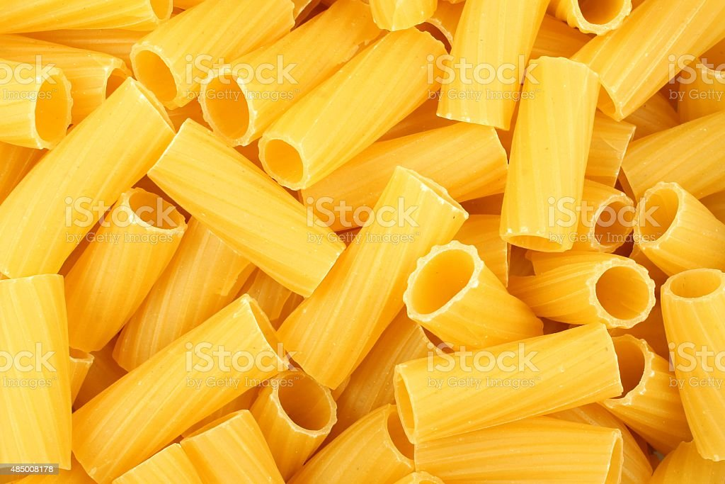 Rigatoni pasta background stock photo