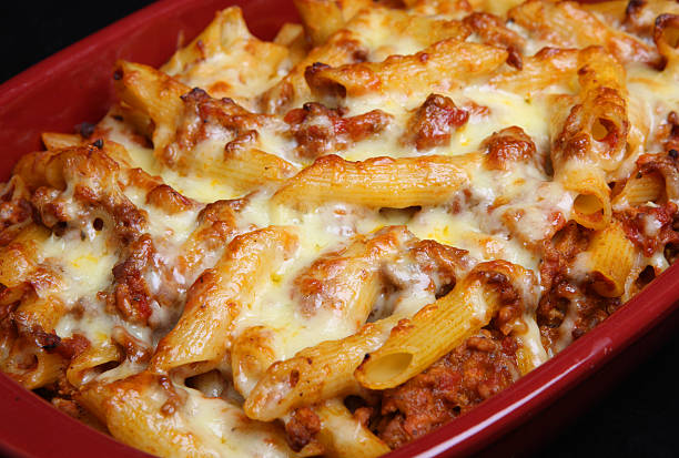 Rigatoni Pasta Gratin Bake Baked rigatoni pasta with bolognese sauce and cheese rigatoni stock pictures, royalty-free photos & images